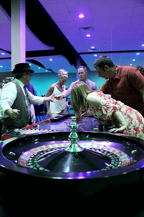attendees playing casino games at event