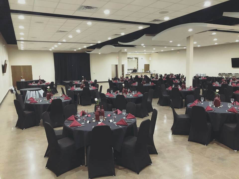 event set up with tables and chairs, black and burgundy accents
