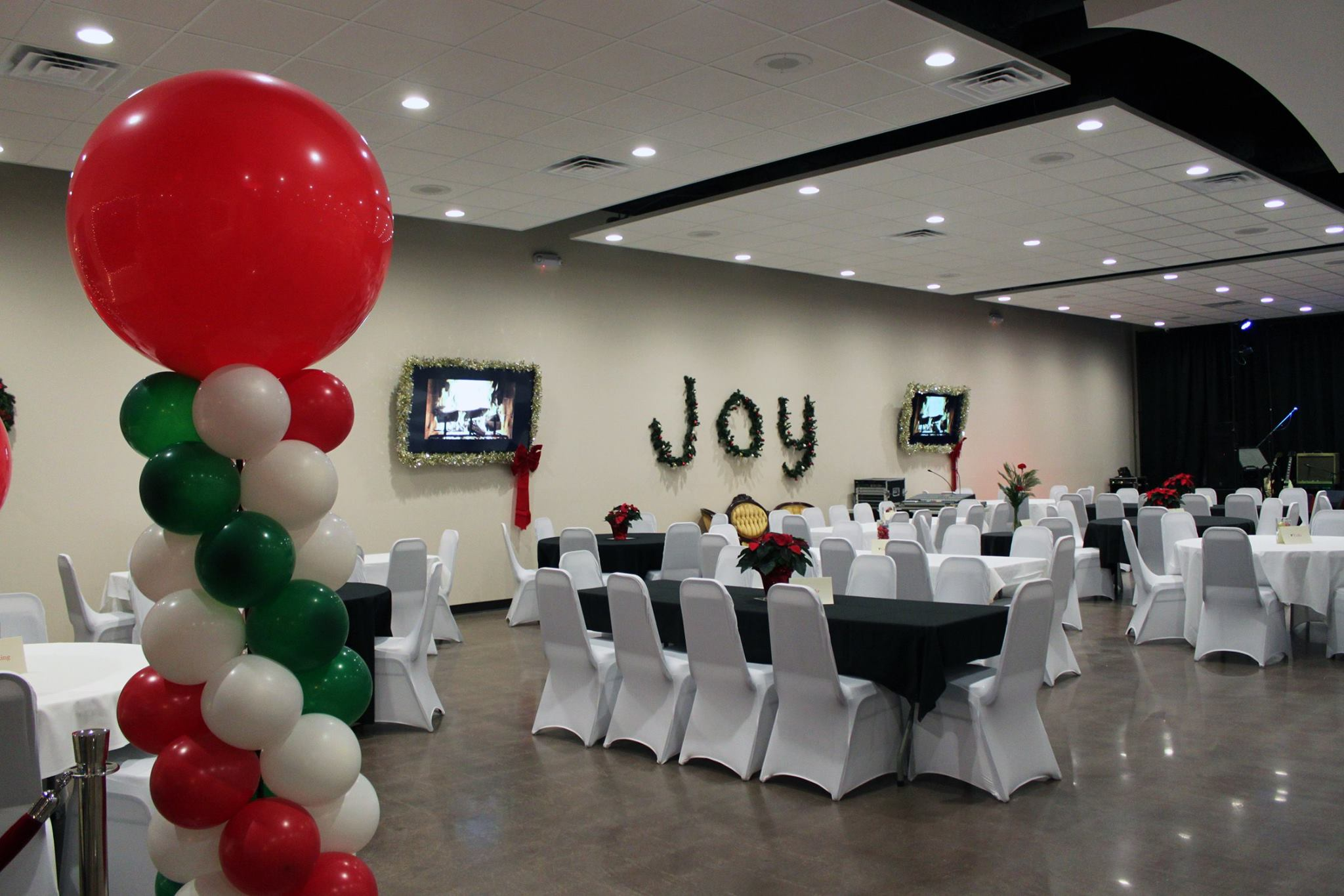 holiday party event setup with balloons and tables
