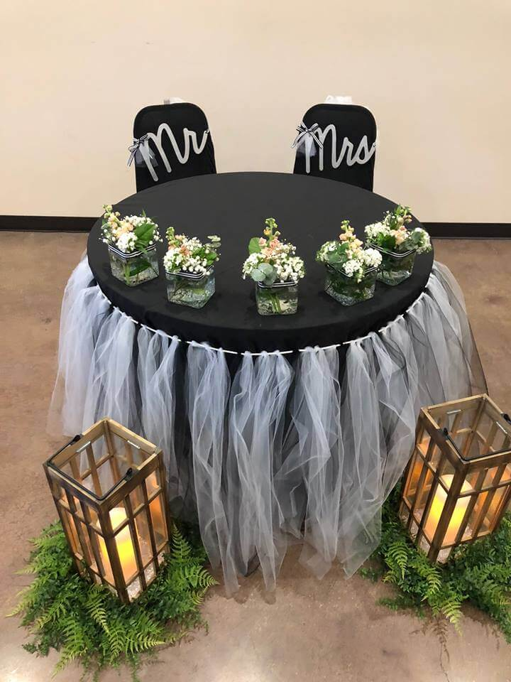 table for married couple at wedding reception