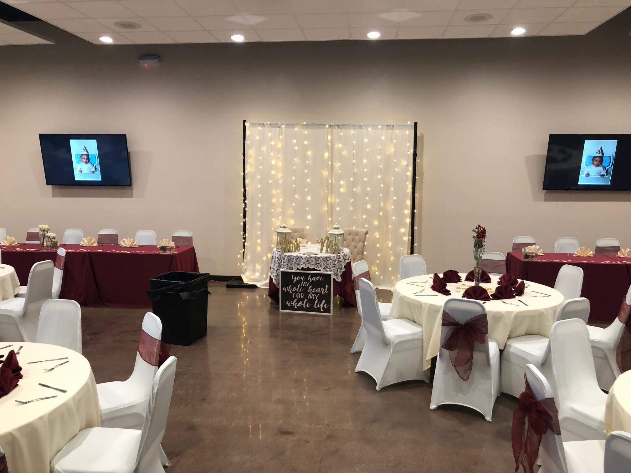 wedding reception set up with tables and chairs