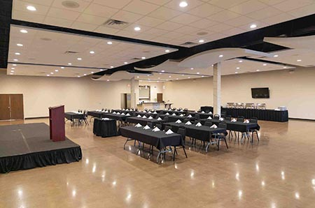 corporate event layout with tables, chairs, stage
