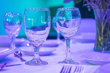 wine glasses on table setup
