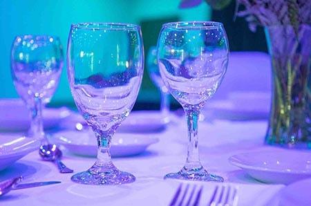 wine glasses on table setup