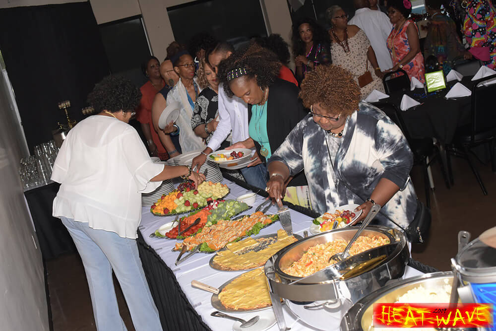 heat wave event at lavela with attendees getting food